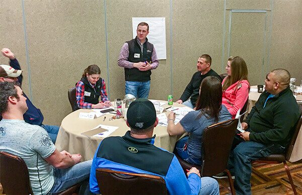 Consultant speaking with Herd Manager Retreat Partcipants